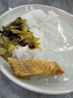Singapore: Less is more. A Zen meal: Salted fish, pickled mustard greens, and plain rice porridge. Satori.