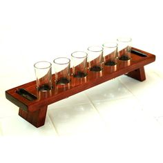 Custom designed tasting flight tray shooter shot glass holder set. Solid wood shot glass carrier has handles on both ends to allow host to carry shots