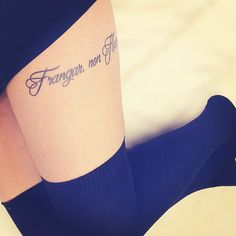 "The tattoo says ""Frangar, non Flectar,"" which translates to ""I will break, but I will not fold."""