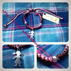 Pulsera de cola de ratón en rosa palo y marrón, detalles plateados y abalorio plano con forma de niña Precio: 2,20 €/unidad