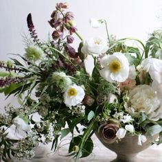 white wild floral arrangement with touches of mauve