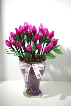 36 roses made from 72 milk chocolate Hershey Kisses. 2 Hershey Kisses are wrapped together to form a beautiful pink rose. Roses are arranged in a large glass vase with a Happy Birthday bow. Approximat