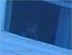 """Close-up of ghost boy at Stanley Hotel. Stanley Hotel, Ghost Tour, October 2, 2009. Little boy looking out open window. No glass or screen in window. The picture-taker sent it to the hotel and this was the response: """"OK, the room number is 1211. Last Friday, there was a single man checked in that room who was part of a business conference. That doesn't mean he DIDN'T have a child with him, but it is unlikely that he did. Cool pic!"""""""