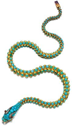 Gold, turquoise, garnet and diamond necklace, 1850s.     Designed as an articulated serpent set with cabochon turquoise, the head decorated with rose diamonds and garnet eyes, length approximately 400mm. Via Sotheby's.