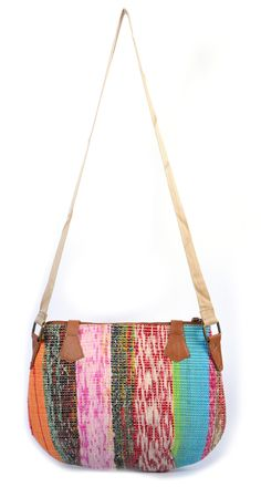 #styleincraft  #buyhandbagsonline #handmadehandbag An elegant multi-colored canvas work bag with genuine leather handle. All the elements which go into making a quality product is monitored right from the first stage of leather selection to finishing of the product at their manufacturing facility. An aesthetic print, invaluable artistic skill, and a