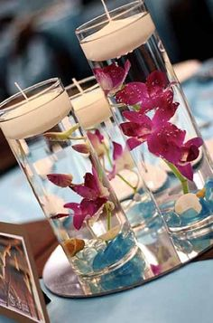 DIY Wedding Centerpieces with orchids and floating candles. Beach Wedding Centerpieces, Wedding Reception Tables, Wedding Decorations, Table Decorations, Diy Centerpieces, Hawaiian Centerpieces, Inexpensive Centerpieces, Graduation Centerpiece, Quinceanera Centerpieces