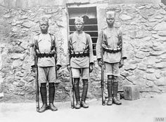 THE CAMPAIGN IN GERMAN EAST AFRICA, 1914-1918. Men of the 1/4th King's African Rifles at Njombe, German East Africa. Formed at the beginning of the century from tribesmen in British East Africa (now Kenya) and Uganda, the KAR bore the brunt of most of the fighting during the campaign.
