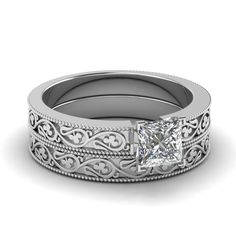 This Wedding #engagementrings Set is vintage inspired solitaire diamond engagement ring with prong set all shape center Stone along with intricately hand etched heart design to complement the center #diamond perfectly. http://jangmijewelry.com/