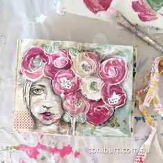 My art journal spread featuring a pencil sketch face and acrylic paint flowers.  Shabby old roses, my favourite!