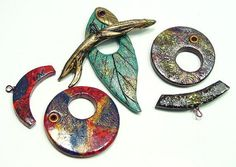 Tina Holden -- Decided to spend a day making Polymer Clay Toggles. Haven't seen anyone make them before, that is I couldn't find any on the Internet. Sometimes I like the look of a functional clasp in the front that can act as a pendant. The branch for the leaf has baling wire as reinforcement. toggles | Flickr - Photo Sharing!
