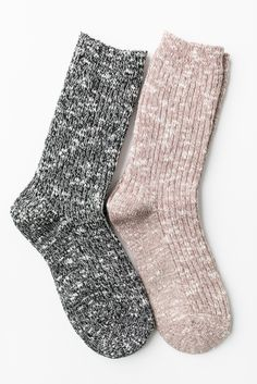 Cozy basic two-toned knit socks. One size fits all. Stretches to mid-length but also looks super cute scrunched around ankles! Available in Beige and Black. - 95% Acrylic 5% Spandex - Imported