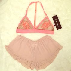 FL&L and Brandy Sexy Blush Sleep Set This color is everything right now! Rock the blush trend for spring in this gorgeous yet super sexy set. Features a beautiful For Love and Lemons mesh lace appliqué t-back bralette and lightweight silky rayon ruffle Brandy Melville Vodi shorts. Both items are brand new with tags, no flaws. Bralette is a size S and shorts are one size fits most. For Love and Lemons Intimates & Sleepwear