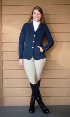Chandler's show coat (by Gersemi) is a modern, versatile option suitable for hunter/jumper or dressage competition. Made of unlined, lightweight, 4-way stretch fabric, it is shaped to fit the body: The waist of the coat falls at Chandler's waist, and there is a smooth taper from her bust to her waist to the bottom edge of the coat. The sleeves are the appropriate length, coming to the bump of her wrist. | © Kelly Anne Berry