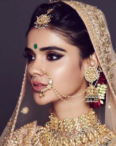 Perfect finishing to a bridal look is given by stunning nose rings! Book the best makeup artist now with BookEventZ to get the perfect bridal look on THE DAY! Indian Bridal Makeup, Bridal Makeup Looks, Indian Bridal Wear, Bridal Looks, Bridal Make Up, Bridal Style, Beautiful Indian Brides, Beautiful Bride, Make Up Braut