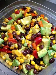 Cowboy Caviar is a melody of black beans, corn, red onion, cherry tomatoes, garlic & avocados marinated in a cilantro lime vinaigrette and served with to...