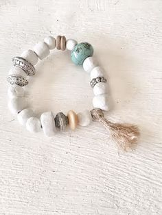 this bracelet is made of handmade white clay beads, metal, bone and turquoise big bead.To wear anytime!!! get yours!!!!