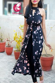 Opt for this in-season Black Crepe Printed Floral Front Slit Kurti from Coloraucion when you need a fashion upgrade. You will look perfect when you pair this up with distressed jeans and high heels. Party Wear Indian Dresses, Indian Fashion Dresses, Indian Designer Outfits, Girls Fashion Clothes, Stylish Kurtis Design, Stylish Dress Designs, Silk Kurti Designs, Kurti Designs Party Wear, Girls Frock Design