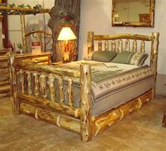 Log bed frame...Still rustic but still put together