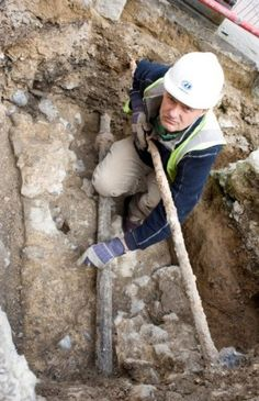 Medieval Dungeon Discovered in England- Tim Allen at the entrance of the medieval dungeon - photo courtesy  South East Water