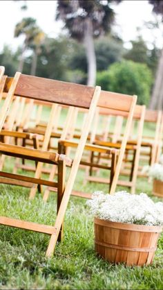 Wedding baskets with baby's breath for our wedding. Love how it looks with the chairs.