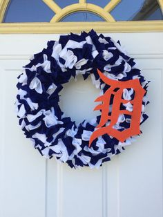 A personal favorite from my Etsy shop https://www.etsy.com/listing/231651514/detroit-tigers-wreath