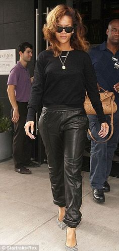 Rhianna rocking leather joggers / trackpants with a snuggly black jumper and statement monochrome heels