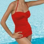 Popina Swimwear :    Retro Swimsuit Jantzen Vamp Maillot One Piece Bathing Suit by Jantzen Swimwear has an elegant silhouette with front shirring. Featuring a detachable strap and soft bra cups. A flattering lower leg for a Vintage, Retro look.      This suit is an exclusive available only at Popina!