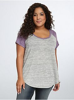 "<p>You'll only be hitting style home-runs in this super cute baseball raglan tee. Grey and white marled knit lends a sophisticated edge, while lavender raglan sleeves and v-neck trim lend a pretty-meets-sporty vibe. A curbed hem keeps the look swinging.</p>  <p> </p>  <p><b>Model is 5'10"", size 1</b></p>  <ul> 	<li>Size 1 measures 28 1/2"" from shoulder</li> 	<li>Polyester/rayon/spandex</li> 	<li>Wash cold, dry flat</li> 	<li>Imported plus size tee</li> </ul>"