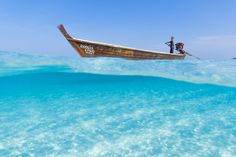 Man Steering a Longtail Boat by MilosPrelevic