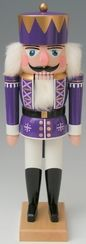 King Nutcracker with Purple Coat by Werkstätte Volker Füchtner - I suppose it's the German in me, but I'm obsessed with Nutcrackers and real Christmas trees. Here is a lovely Nutcracker in purple, white and gold.
