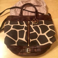 REDUCED$💝 animal print Michael Kors large bag Beautiful brown &cream animal print Michael Kors ❤️from Their catalog! good condition, used for a short time,just scrap marks on bottom brown leather part, as new 1st  pic shows Could maybe shade in permanent br. Marker.brown leather straps & pockets on the inside cool zipper & great hard ware on the outside!!Gold MK tag &feet on bottom too! no trades no pay! please only serious buyers if any questions as I travel a bit for work - thanks for…