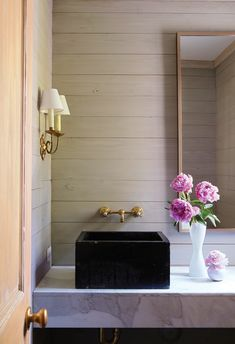 Rustic powder room with wood paneled walls. #small #bathroom #design