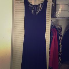 Black dress Cute black dress. Lacey back. Worn once. Cute to just spend the day in! Comfy material! Not as long as it looks! Dresses