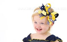 "Your lil' Wolverines fan will be ready to ""howl"" for her team with this navy blue and yellow chevron hair bow for girls from Beautiful Bows Boutique.  Handmade in delicate ... #sportsbows #footballbows #schooluniformhairbows #babyheadbands #babybows #sale"