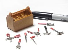 """This mini toolbox is a must have for your mini garage! Comes with shears, pliers, two types of hammers, two types of wrenches, saw, and screwdriver. Box itself is made of wood and approximately 1.75"""""""