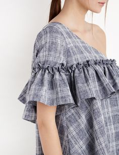 Cute grid printed one shoulder top with asymmetric ruffle. Babydoll shape. By…