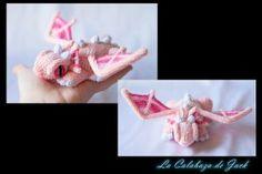 Pink crochet dragon By Cristell Justicia/La calabaza de Jack ->Follow my work: ~Facebook: https://www.facebook.com/LaCalabazaDeJack ~Tumblr: http://lacalabazadejack.tumblr.com/ ~Deviantart: cristell15.deviantart.com   #Amigurumi #Pattern #Crochet #Knitting #Yarn #Felt #Felted #Plush #Toy #Doll #Handmade #Craft #Dragon #Monster #Beast #Pink #Cute #Kawaii #Freak #Geek #Fantasy #Medieval