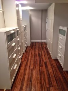 Bennion Tudor Cottage Renovation: Everything Is Awesome! -- basement storage. IKEA brimnes mixed with pax--vinyl wood flooring