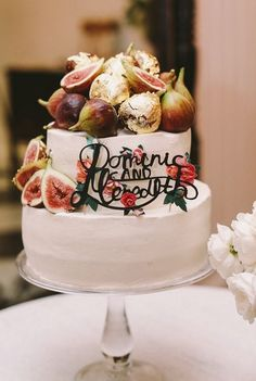Uniquely decorated two tier wedding cake; Featured Photographer: Lara Hotz Photography
