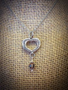 A personal favorite from my Etsy shop https://www.etsy.com/listing/248535493/tibetan-silver-heart-necklace-with-czech