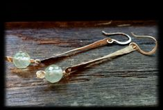 14k Gold Twisted Twig and Prehnite Drops Hand Formed and Hammered Earrings by PetiteMaus, $35.00  Faceted mint green prehnite rounds suspended from hand hammered and twisted 14k gold twigs. so lovely! Perfect fall back to school earrings