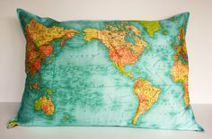 This bright map pillow would add a pop of color to a room. #accessories