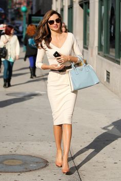 Miranda Kerr - looks polished on and off the runway. Like this dress and purse for work.