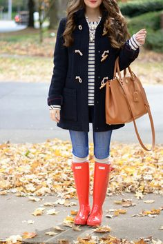 navy duffle coat and red wellies