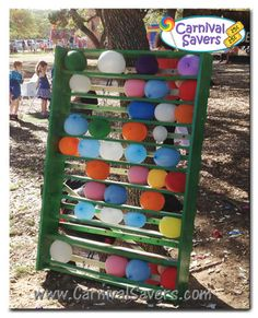 dart-less balloon pop . on the back of the shelving are wooden strips with tacks. Kids throw beanbags at the balloons, the balloons are pushed back onto the tack, and pop Backyard Carnival, Fall Carnival, Halloween Carnival, Halloween Games, Balloon Pop Game, Balloon Games For Kids, The Balloon, Carnival Games For Kids, Carnival Themes