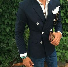 Classic blazer...accessories on point...fitted blue jeans...sexy