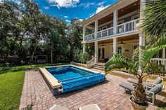 Off the veranda in this Saint Augustine home, a partially in-ground Endless Pools® swimming machine.