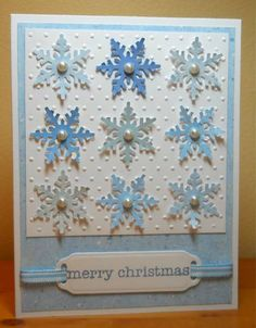 Snowflakes. Pretty in shades of light blue, background embossed with dots. [This link goes to splitcoaststampers' home page. I couldn't find the card, but the picture will do.] (Jan'13)