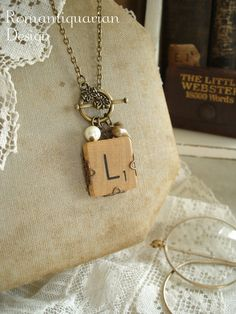 with skeleton key.....SCRABBLE Letter Necklace - Letter L Necklace. Initial Necklace. Vintage Wood Tile in Antiqued Brass Filigree. Rustic Monogram Necklace. i actually like this lol