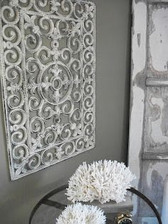 Dollar Store door mat & Antique craft paint . So cool! im thinking of puttling a mirror behind it, and maybe cutting out the center